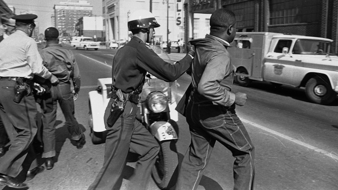 Martin Luther King, Jr., left, and Rev. Ralph Abernathy, right, being dragged off by police following a demonstration in Birmingham, Alabama. (Credit: Horace Cort/AP/REX/Shutterstock)