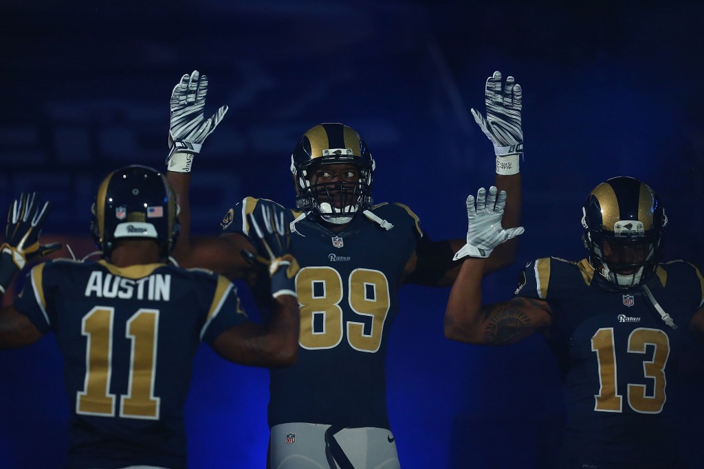 The St. Louis Rams pay homage to Michael Brown by holding their hands up during their pre-game introduction against the Oakland Raiders, November 30, 2014. (Credit: Dilip Vishwanat/Getty Images)
