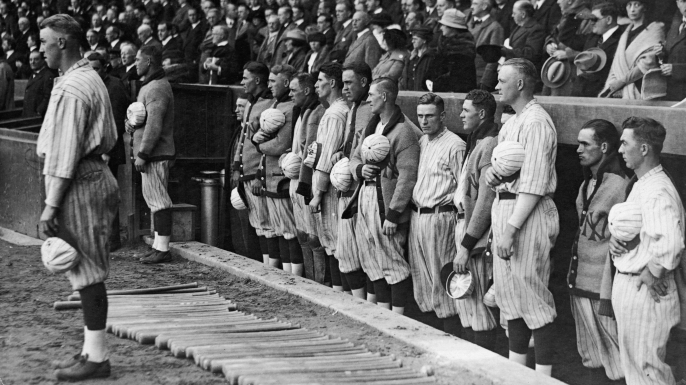 The New York Yankees hold their caps over their hearts during a performance of the national anthem, 1921. (Credit: FPG/Getty Images)