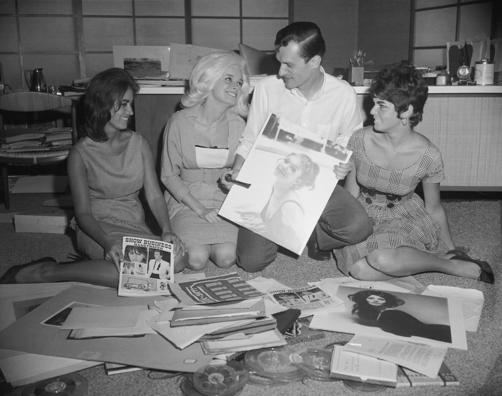 Playboy publisher Hugh Hefner working on image selection for publication. (Credit: Bettmann/Getty Images)