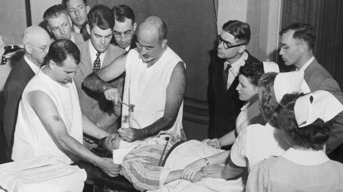 Dr. Walter Freeman performing a lobotomy. (Credit: Bettmann/Getty Images)