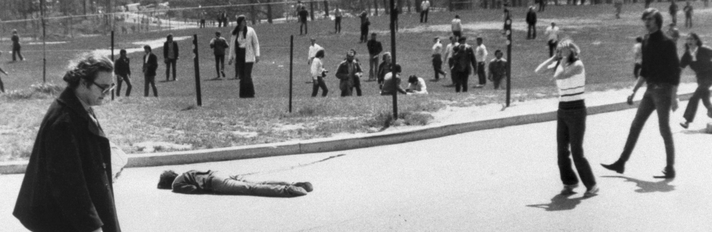 (Original Caption) Clasping her head in anguish, coed reacts with horror upon seeing body of student who was shot and killed by National Guardsmen during war protest rally at Kent State University here May 4th. The slain girl is one of two girls and boys killed by the National Guard during the disorders.