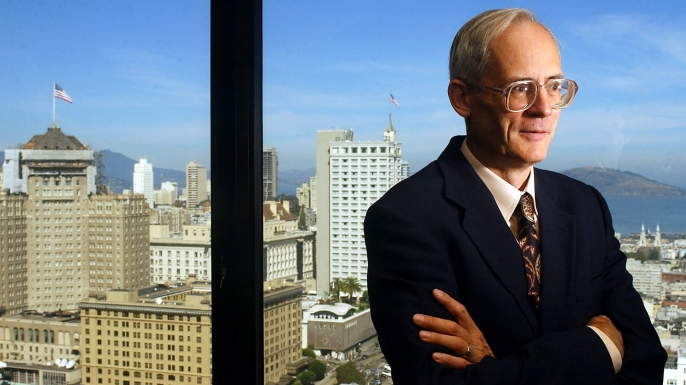 Ted Benna, head of the 401(k) Association, poses for a portrait in a San Francisco hotel, 2002. (Credit: Marcio Jose Sanchez/AP Photo)
