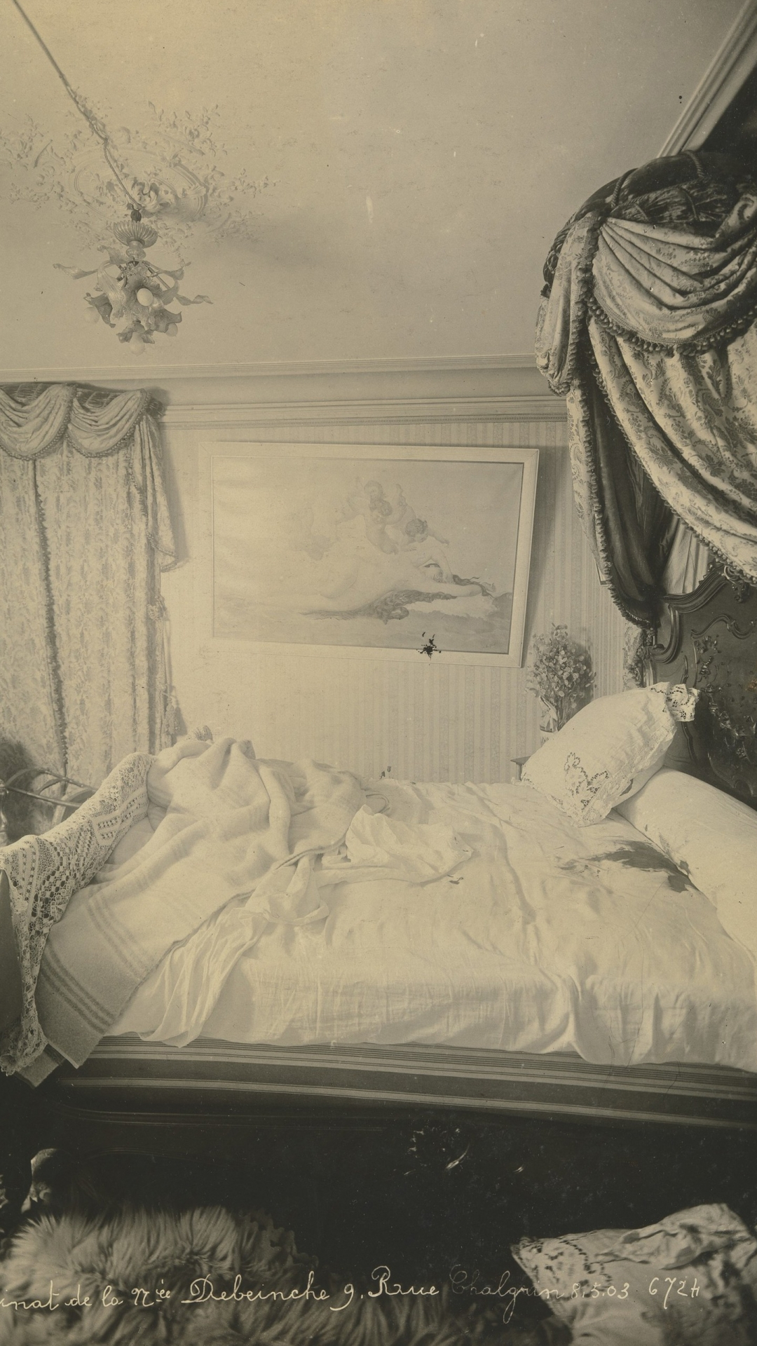 Bedroom of Madame Debeinche, murdered May 5, 1903. From this angle, the scene looks unsettling, with the picture askew and the dark stain on the bed. (Credit: The Metropolitan Museum of Art)