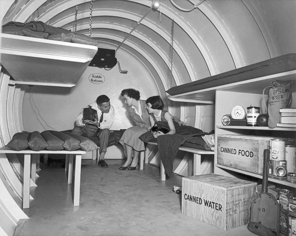 A Long Island family sits in a 'Kidde Kokoon,' an underground bomb shelter manufactured by Walter Kidde Nuclear Laboratories, in Garden City, New York, c. 1955.
