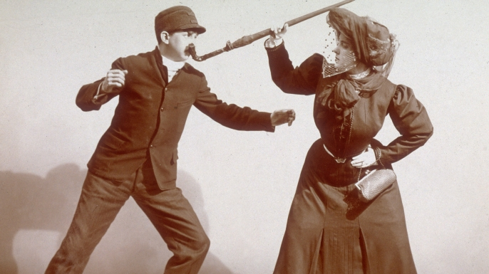 A woman using her umbrella during a 'Lesson In the Art of Womanly Self-Defense', 1906.  (Credit: Museum of the City of New York/Byron Collection/Getty Images)
