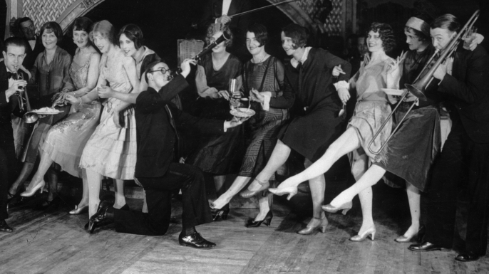 Flappers dancing while musicians perform during a Charleston dance contest at the Parody Club, New York City, 1926. (Credit: Hulton Archive/Getty Images)