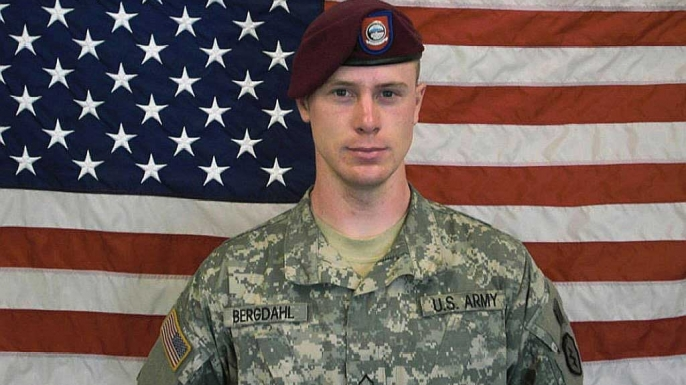 U.S. Army, Sgt. Bowe Bergdahl poses in front of an American flag. (Credit: U.S. Army via Getty Images)