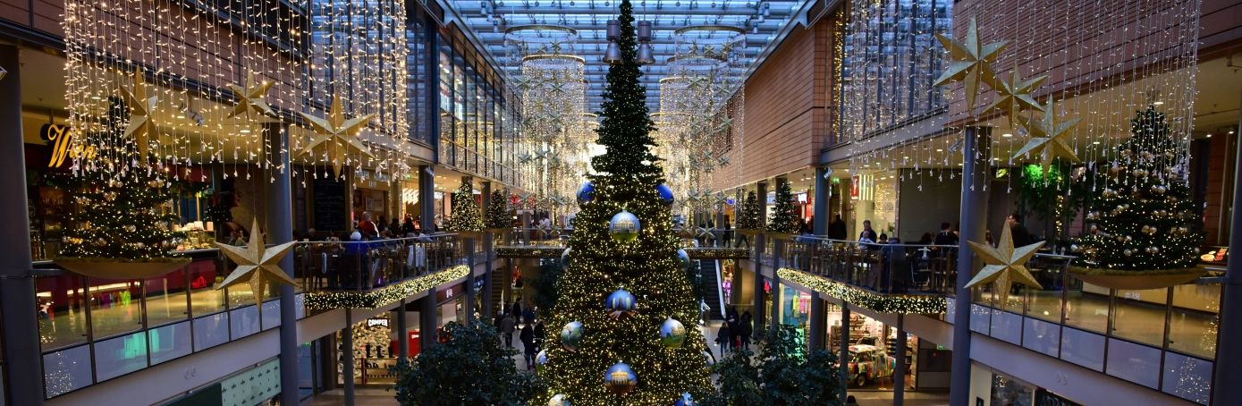 A Christmas tree in the main aisle of a shopping mall. (Credit: John MacDougall/AFP/Getty Images)
