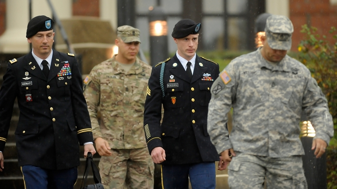 U.S. Army Sgt. Bowe Bergdahl (second from right) leaves a military courthouse with his attorney Lt. Col. Franklin Rosenblatt (left) on December 22, 2015, in Ft. Bragg, North Carolina. Bergdahl following his arraignment on charges of desertion and endangering troops stemming from his decision to leave his outpost in Afghanistan in 2009.