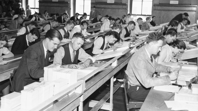 Clerks working in the U.S. Census Bureau office at St. Louis, cataloguing the names of the 75,994,575 Americans listed in the 1900 census, which was used to determine the Social Security rolls.