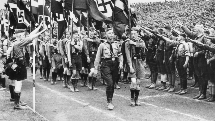 Germany's young fascists receive famous salute during a mass march in Berlin, 1934. (Credit: Bettmann/Getty Images)