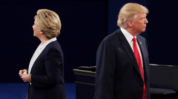 Democratic presidential nominee former Secretary of State Hillary Clinton and Republican presidential nominee Donald Trump listen during the town hall debate at Washington University, 2016 in St Louis, Missouri. This is the second of three presidential debates scheduled prior to the election. (Credit: Chip Somodevilla/Getty Images)