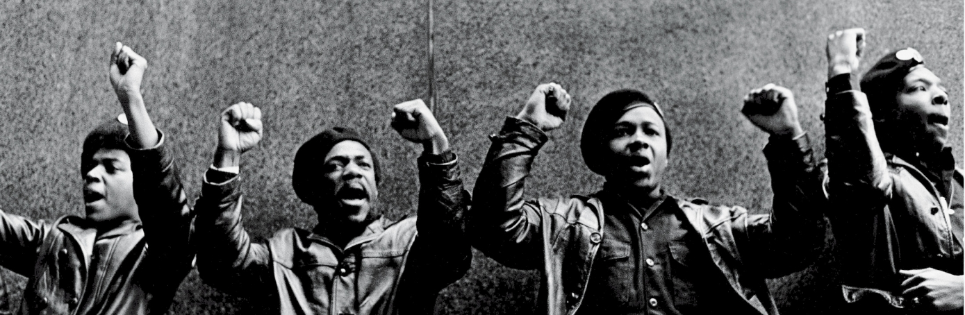 View of a line of Black Panther Party members as they stand outside the New York City courthouse under a portion of an Abraham Lincoln quote which reads 'The Ultimate Justice of the People,' New York, New York, April 11, 1969. (Credit: David Fenton/Getty Images)