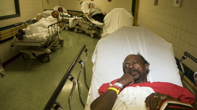 Grady Memorial Hospital in Atlanta, where many patients are forced to wait for treatment in the hallways due to lack of space and over crowding in the emergency room, 2006. (Credit: Jonathan Torgovnik/Getty Images)