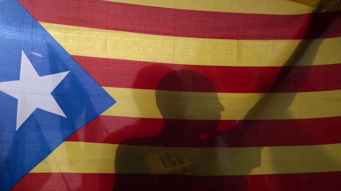 A man holds a Catalan pro-independence 'Estelada' flag during a demonstration in support of the referendum in Catalonia on October, 2017. (Credit: Jorge Guerrero/AFP/Getty Images)