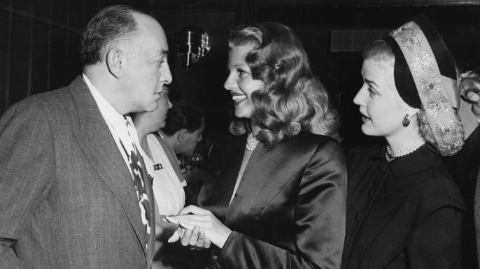 Harry Cohn with Rita Hayworth and Anita Louise, 1946. (Credit: Columbia/Kobal/REX/Shutterstock)