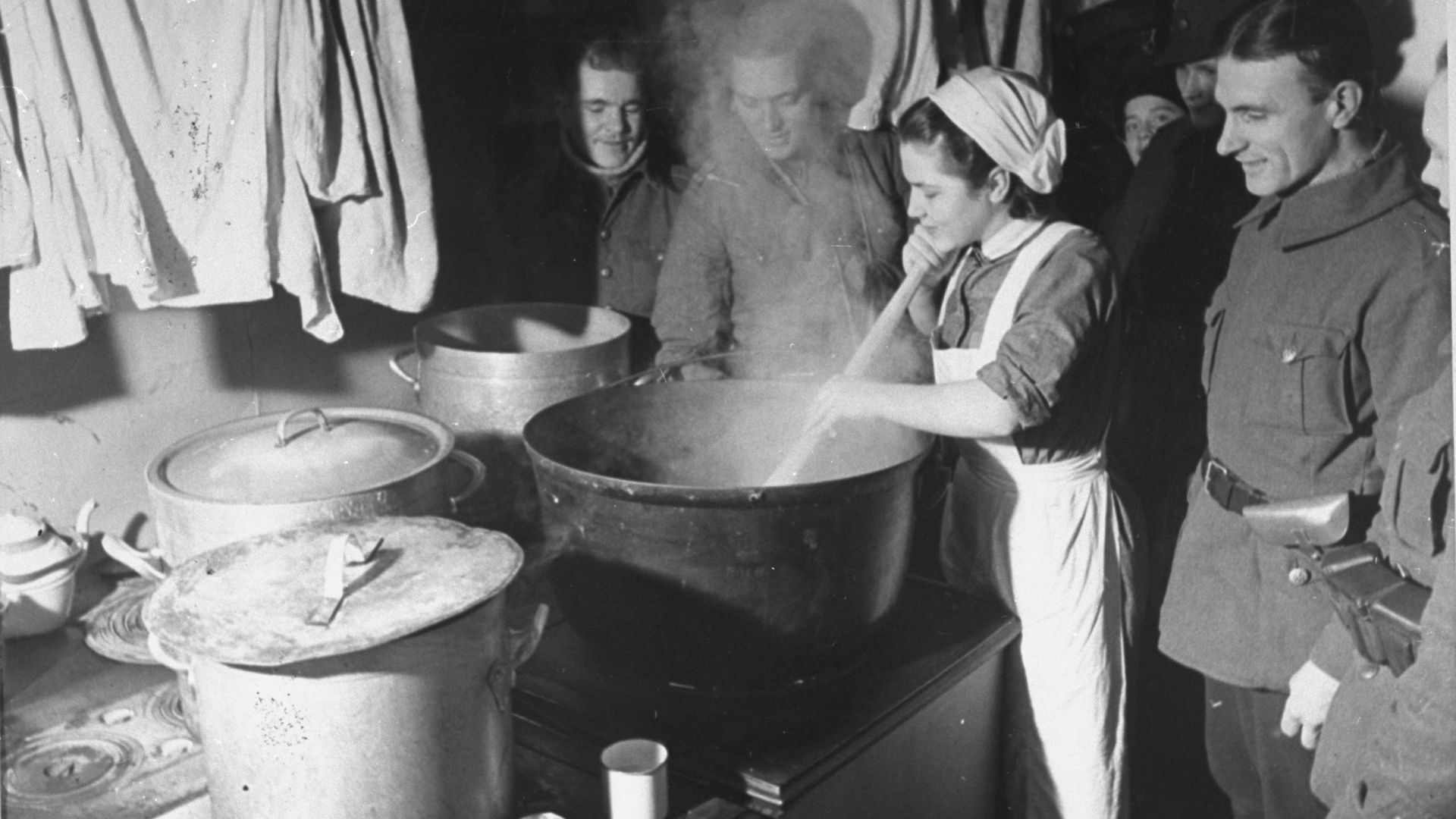 Finnish soldiers watching the preparation of their meal during their war with Russia. (Credit: Carl Mydans/The LIFE Picture Collection/Getty Images)