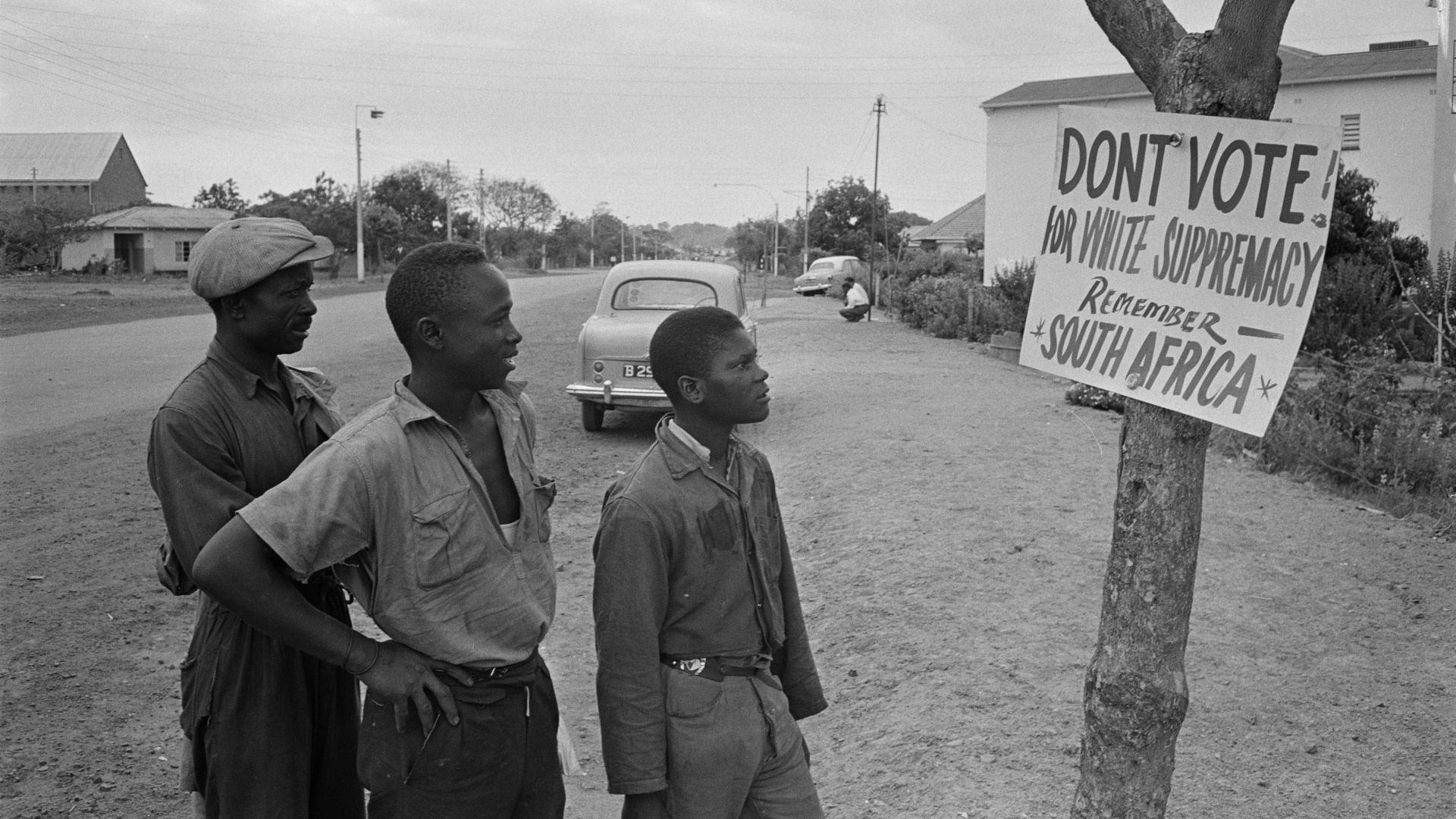 Local residents reading a voting sign during elections in Southern Rhodesia, 1964. (Credit: Daily Express/Hulton Archive/Getty Images)