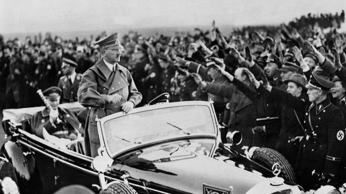Hitler driving through Berlin after is arrival to the Tempelhof Airport from Vienna. (Credit: Ullstein Bild via Getty Images)