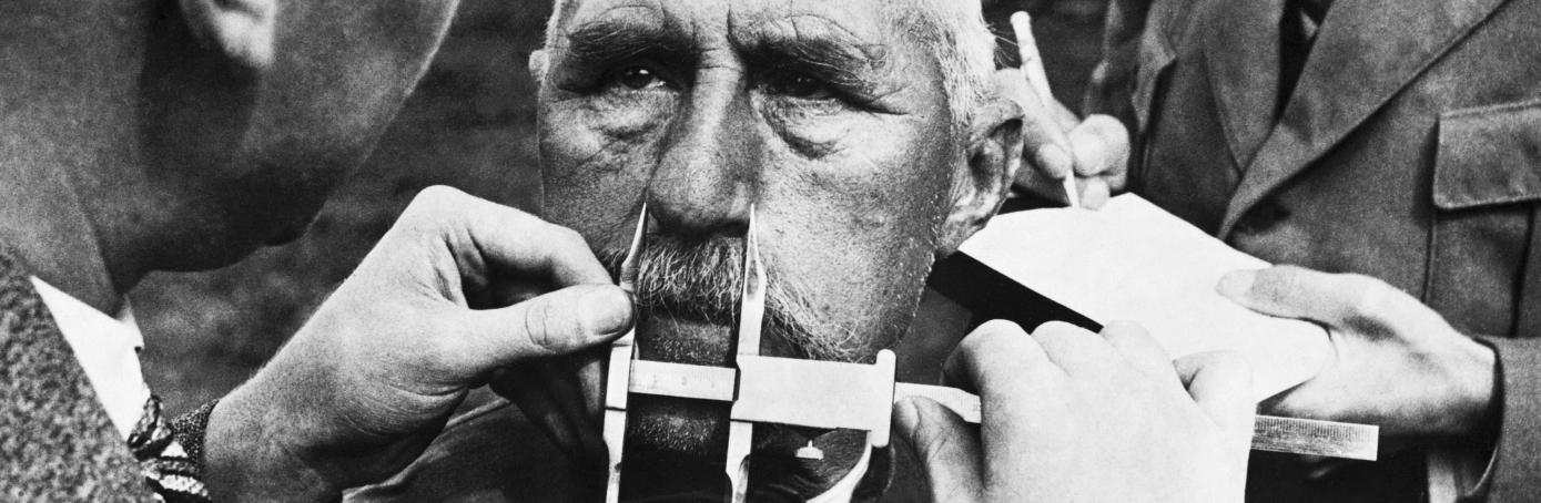 "The Nazis developed a system of facial measurement that was supposedly a way of determining racial descent. The compiled results, based on biased samples, were used to back up the Nazi claim that Germans were a pure and superior ""Aryan"" race. (Credit: Hulton-Deutsch Collection/Corbis via Getty Images)"
