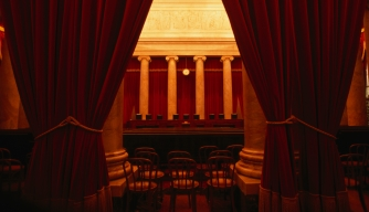 Behind the curtain is the Supreme Court of Washington DC. (Credit: Lonely Planet/Getty Images)