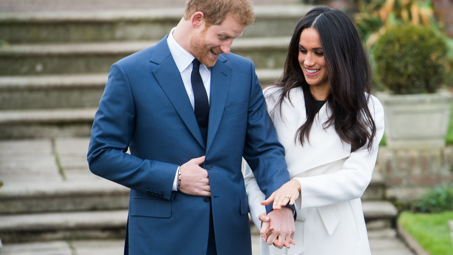 Prince Harry and Meghan Markle announcing their engagement at the Sunken Gardens at Kensington Palace, November 27, 2017. (Credit: Samir Hussein/Samir Hussein/WireImage)