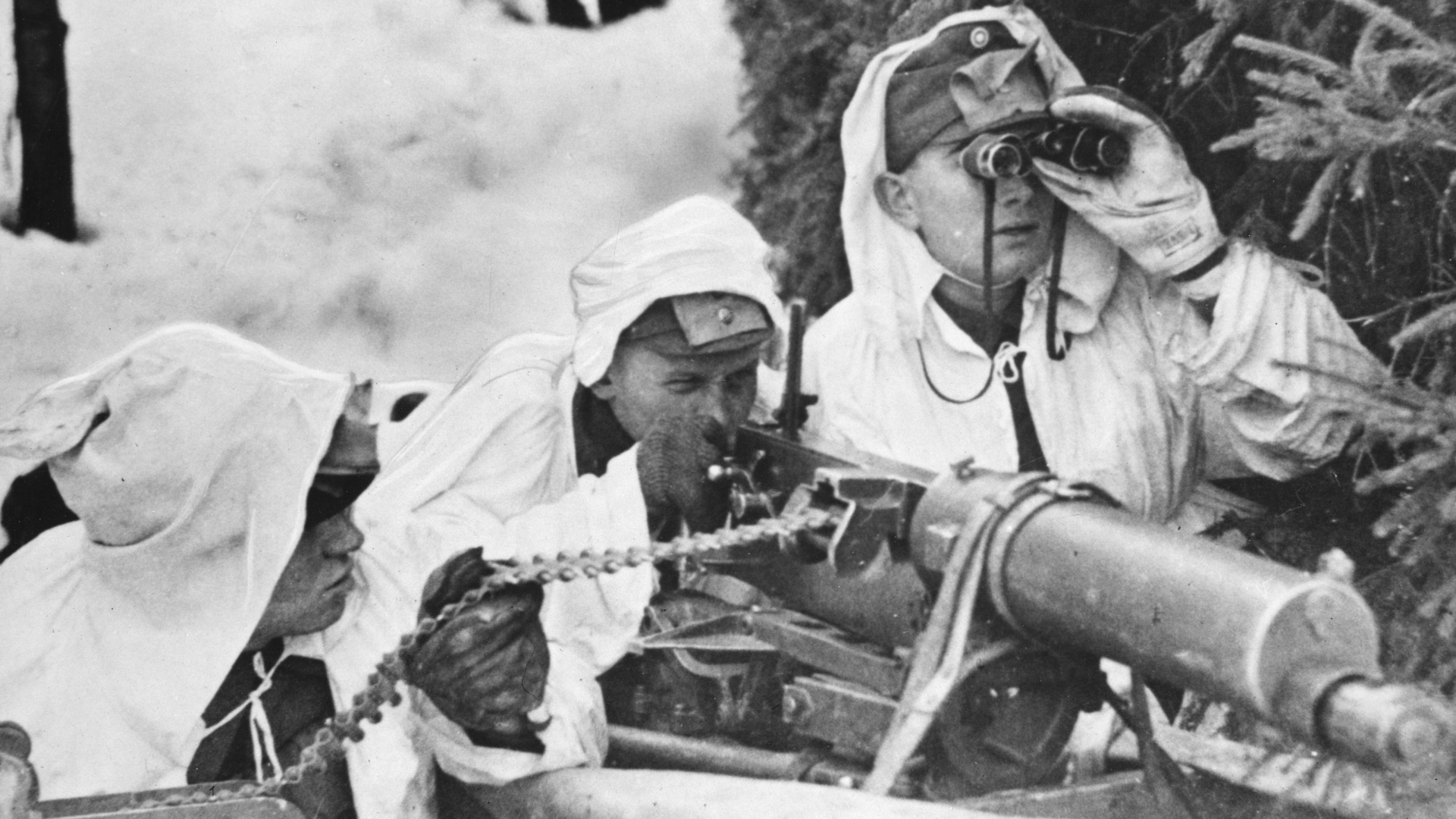 A Finnish machine-gun crew, wearing white to blend with the background of snow, in action against Russian troops during the Winter War. (Credit: Hulton-Deutsch Collection/CORBIS/Corbis via Getty Images)