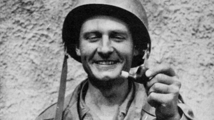 Emil Kapaun holding a broken tobacco pipe that had been shot out of his mouth by a sniper as he crawled forward in battle to drag American GIs to safety. (Credit: The Wichita Diocese)