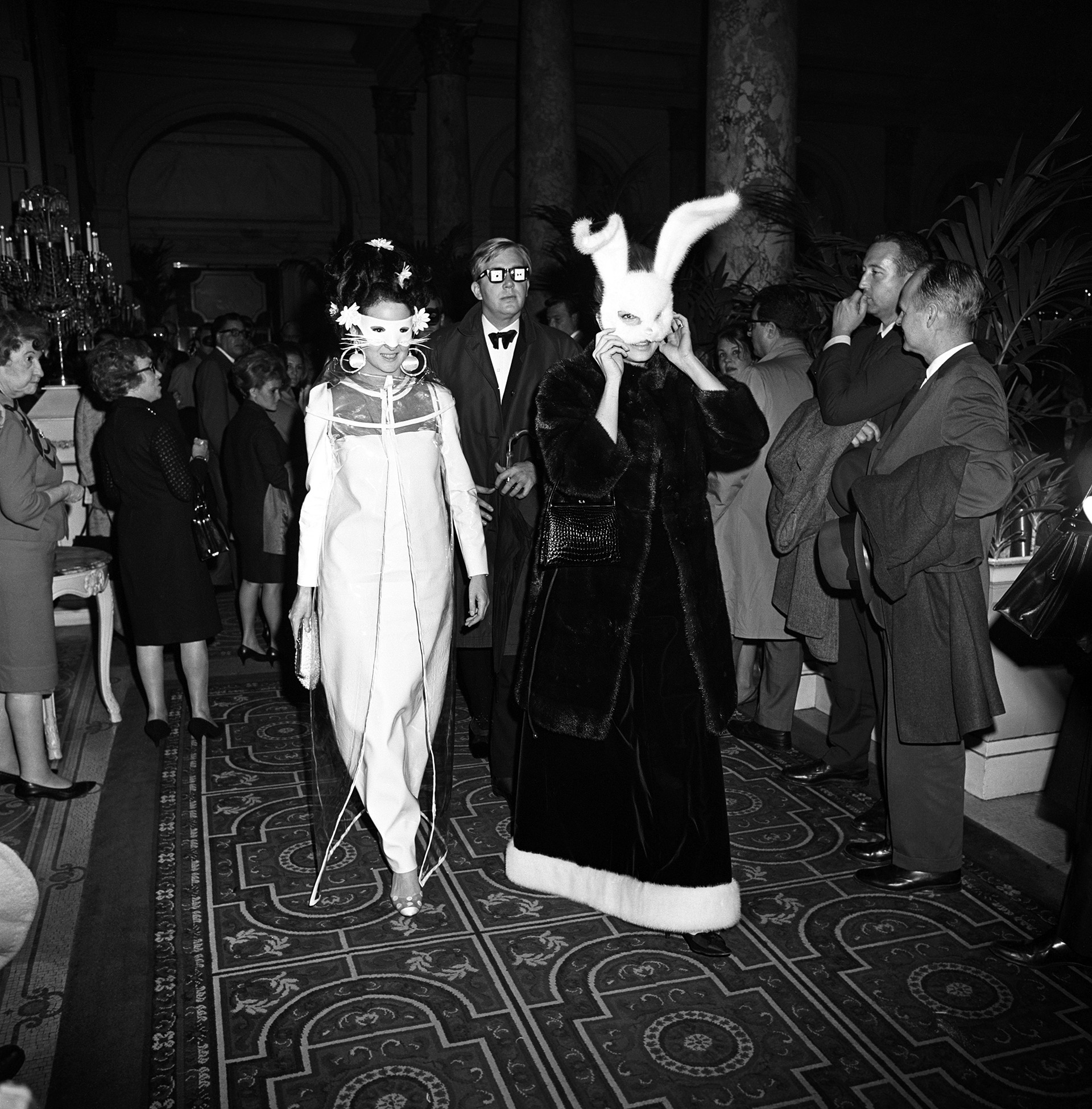 Candace Bergen (right) and another woman arriving at Truman Capote's Black and White Ball in the Grand Ballroom at the Plaza Hotel in New York City, 1966. (Credit: Morrison Ray ''Scotty/Penske Media/REX/Shutterstock)