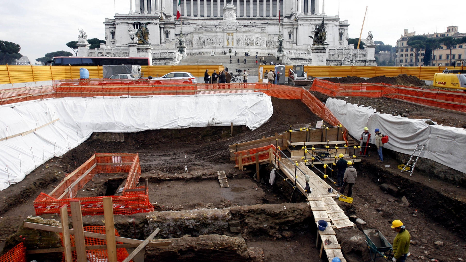 Archaeologists working in an archaeological dig in Rome's central Piazza Venezia Square in 2007, in preparation for a new subway line, where a sixth-century copper factory have been found. (Credit: Alessandra Tarantino/AP Photo)