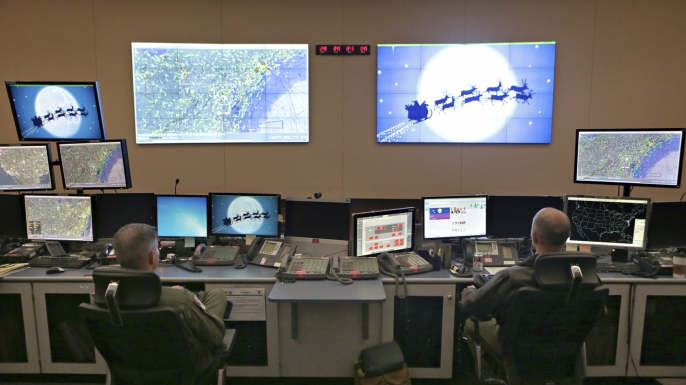 Members of the 601st Air Operations Center will watch Santa fly around the world on Christmas Eve with their NORAD Santa tracker in Panama City, Florida. (Credit: Heather Howard/News Herald via AP Photo)