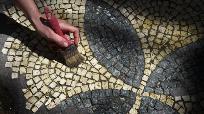 Subway construction workers in Rome found 2,000 year old military neighbourhood complete with 39 rooms, ornate mosaics and even a graveyard in 2016. The ancient barracks cover 900 square meters and include a long hallway and rooms decorated with black-and-white mosaics on the floors and frescoed walls. (Credit: Eric Vandeville/Sipa USA/AP Photo)