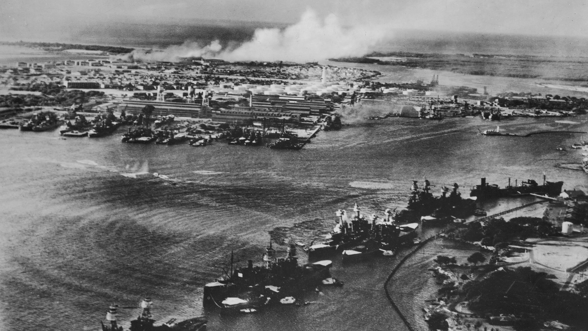 Captured Japanese photo showing aerial view of the attack on Pearl Harbor with ripples and waves around US battleships hit by Japanese torpedoes. (Credit: Time Life Pictures/US Navy/The LIFE Picture Collection/Getty Images)