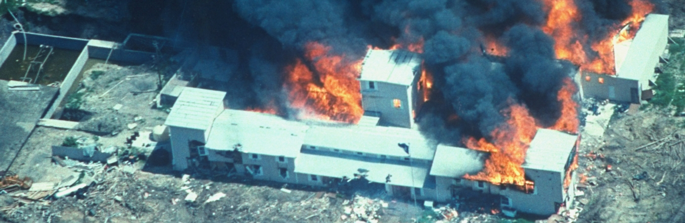 Overhead of smoking fire consuming David Koresh-led Branch Davidian cult compound. (Credit: Time Life Pictures/Fbi/The LIFE Picture Collection/Getty Images)