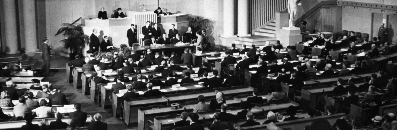 (Original Caption) 12/13/1949- Lausanne, Switzerland- A general view of the chamber during the signing of the Geneva Conventions drawn up in diplomatic conferences last year setting forth new rules of war. Principal among them is the agreement for the treatment of civilian populations in occupied countries. Feeding of such civilians is a duty of the occupying powers.