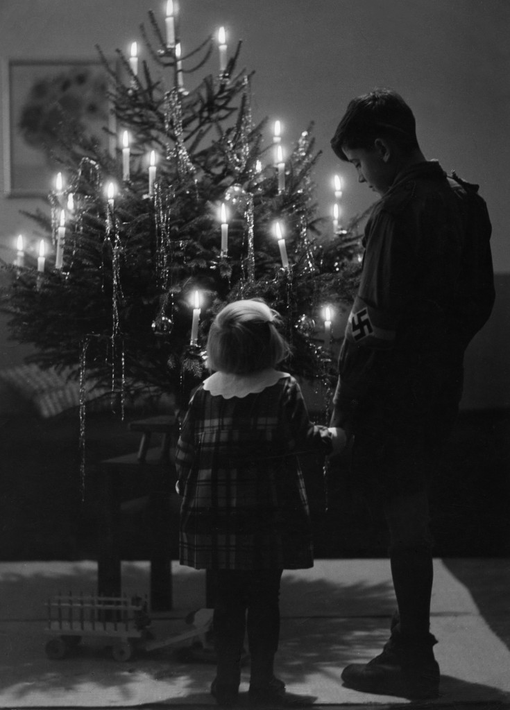 A Hitler Youth and a small girl in front of a Christmas tree , 1938. (Credit: Max Ehlert/ullstein bild via Getty Images)
