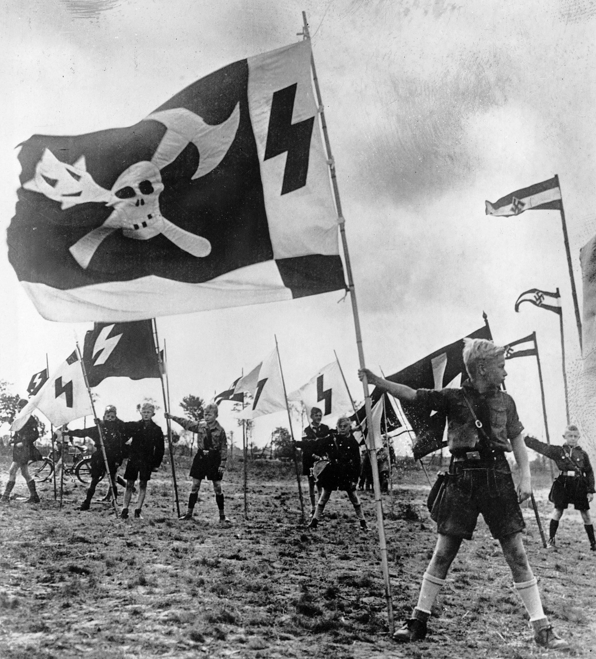 From the sixth year of age, German boys have to join the Nazi organization of youth. Equipped with uniforms and flags, they undergo strenuous physical training that leaves them well prepared for the two years they will later serve in the Wehrmacht. (Credit: Hulton-Deutsch Collection/Corbis via Getty Images)