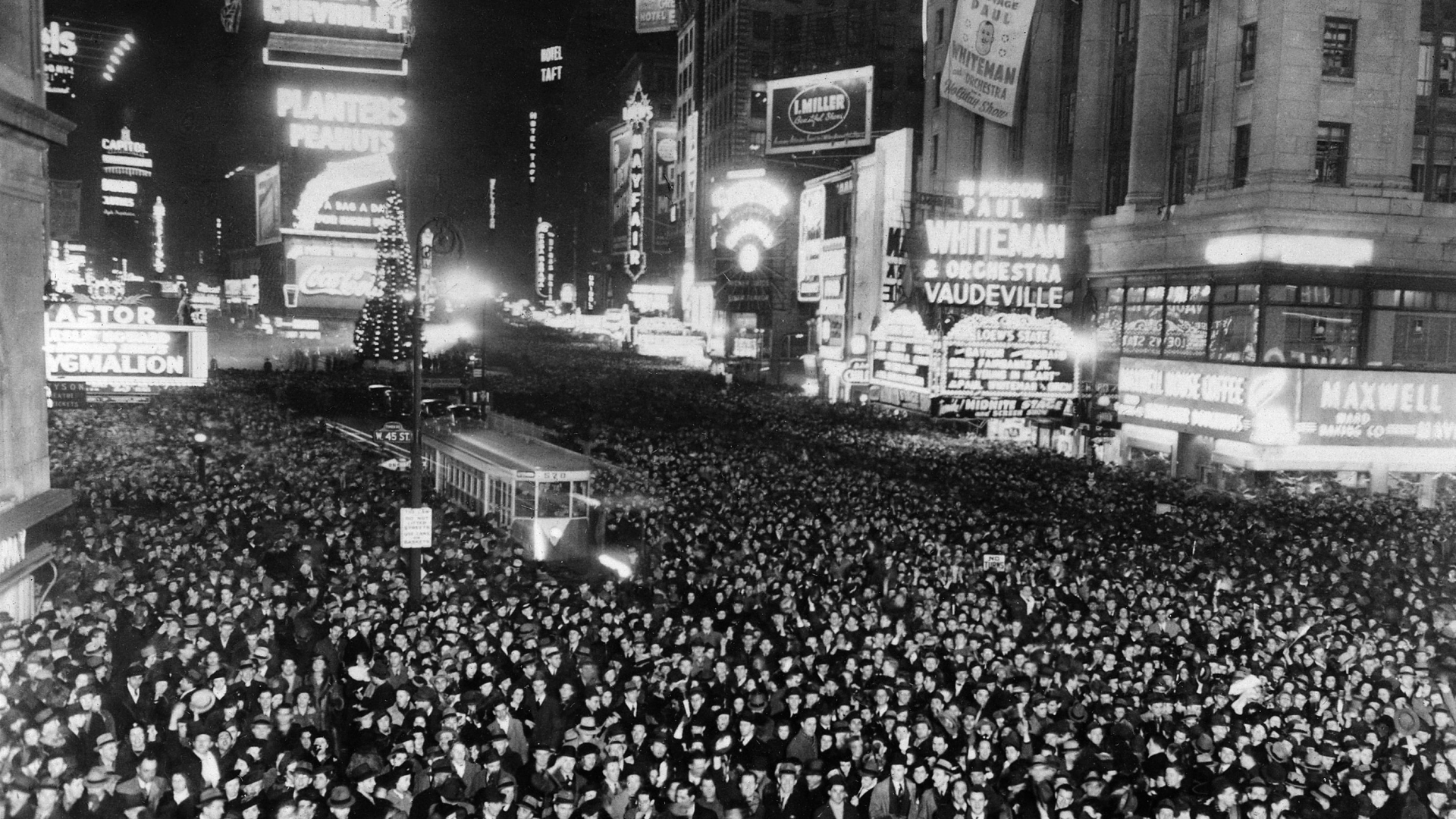 People gathering in Times Square to celebrate the New Year Eve, 1938. (Credit: France Presse Voir/AFP/Getty Images)