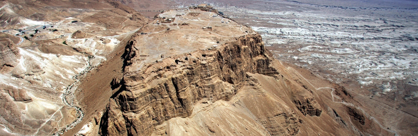 Masada, ISRAEL: An aerial photo of the ancient hilltop fortress of Masada in Judean desert,  20 April 2007. A new museum will be inaugurated 03 May 2007 and will house the archeological findings of the Herodian Palace. Masada was the mountain fortress constructed by King Herod that was occupied by Jewish rebels after the Jewish revolt in the first century. The rebels defended themselves from a Roman army for months. When it appeared that the Romans would finally conquer the fortress hundreds of rebels committed suicide rather than be taken prisoner by the Romans. Although this fort is not mentioned in the Bible it does give insight into the Roman military method as well as the life of King Herod and his construction.  AFP PHOTO/MENAHEM KAHANA (Photo credit should read MENAHEM KAHANA/AFP/Getty Images)