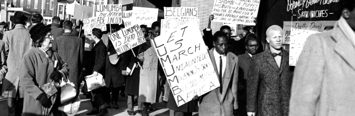 BOSTON, MA - FEBRUARY 21: A group of African students protest the killing of Congo Premiere Patrice Lumumba on Tremont Street in Boston on Feb. 21, 1961.  (Photo by Paul J. Maguire/The Boston Globe via Getty Images)