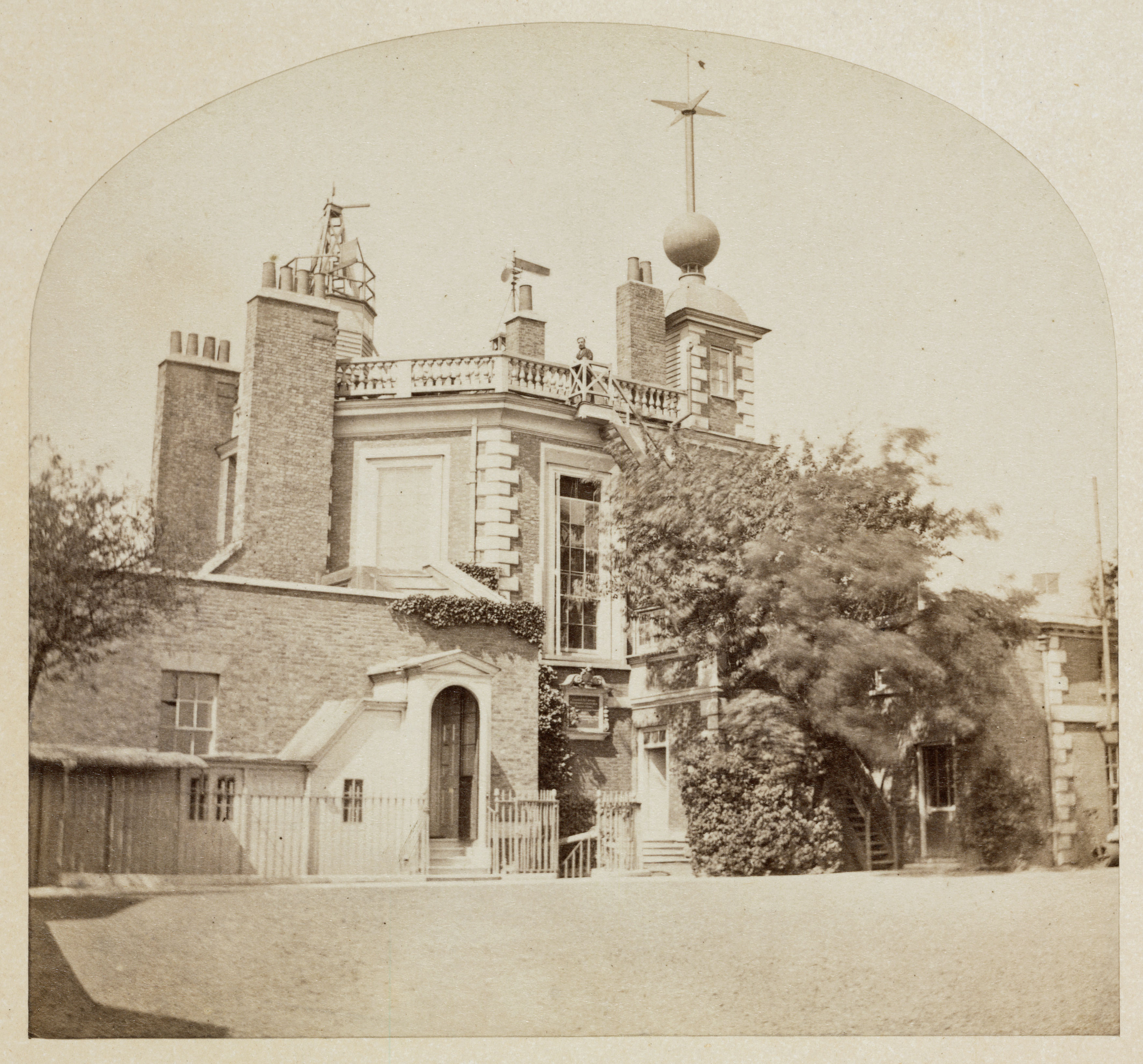 A photograph of the Flamsteed House at the Royal Observatory, Greenwich in the mid nineteenth century. On top shows the time ball, a device that was used to help sailors reset their chronometers from ships in the nearby London docks. Five minutes in advance the ball was raised to the top of its pole and was dropped at the exact moment of 1 pm. The practice is still continued to this day despite the observatory now forming part of the National Maritime Museum. (Credit: SSPL/Getty Images)