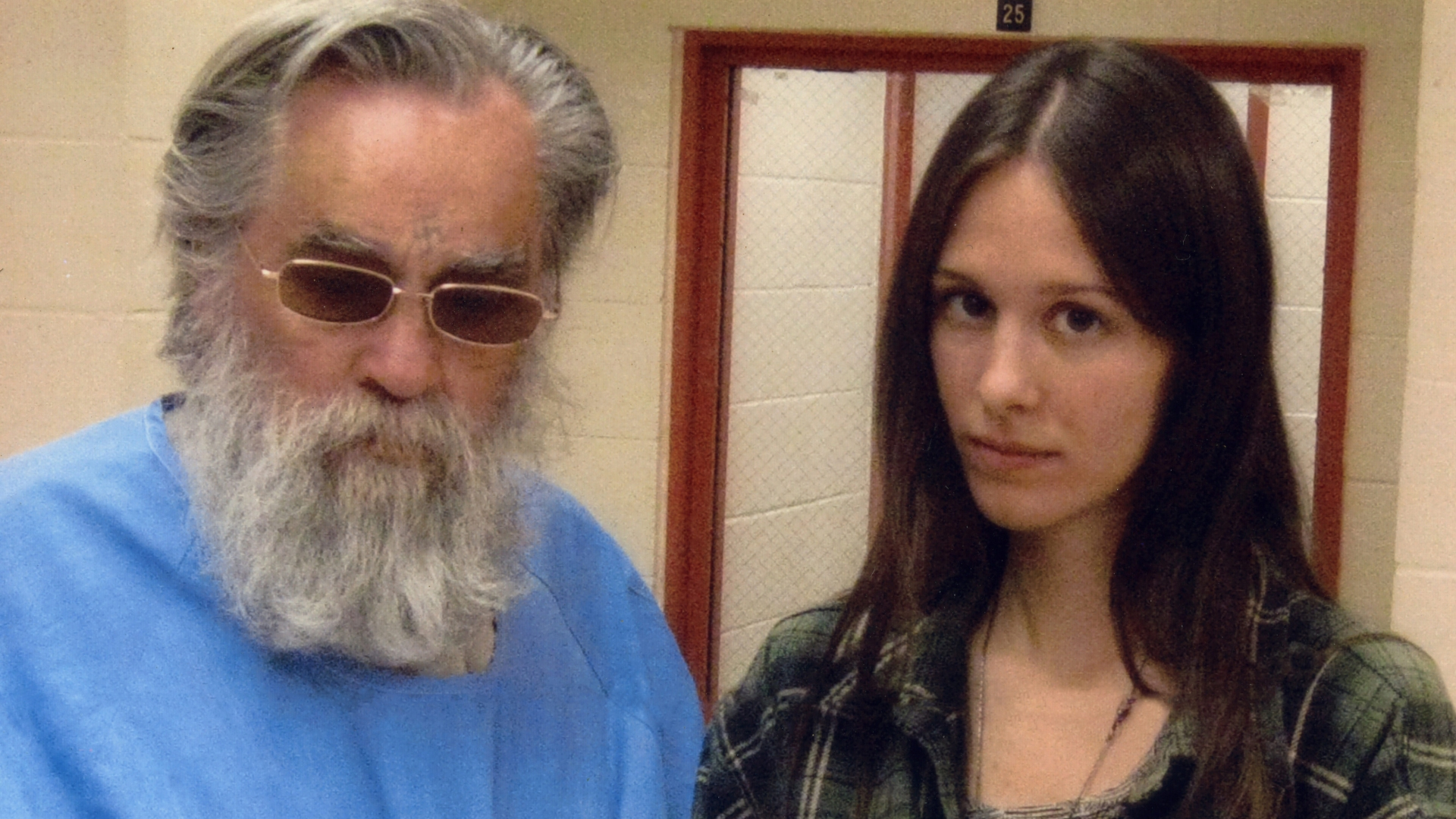 Charles Manson and the 25-year-old 'fan' he named Star who started by visiting him every Saturday and Sunday before they got engaged. She moved near the Corcoran State Prison when she was 19, to be closer to him and carved an X into her forehead, as many Manson followers have done over the years. (Credit: Polaris Images)
