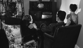 A family sitting around their television, 1945. (Credit: Harold M. Lambert/Getty Images)