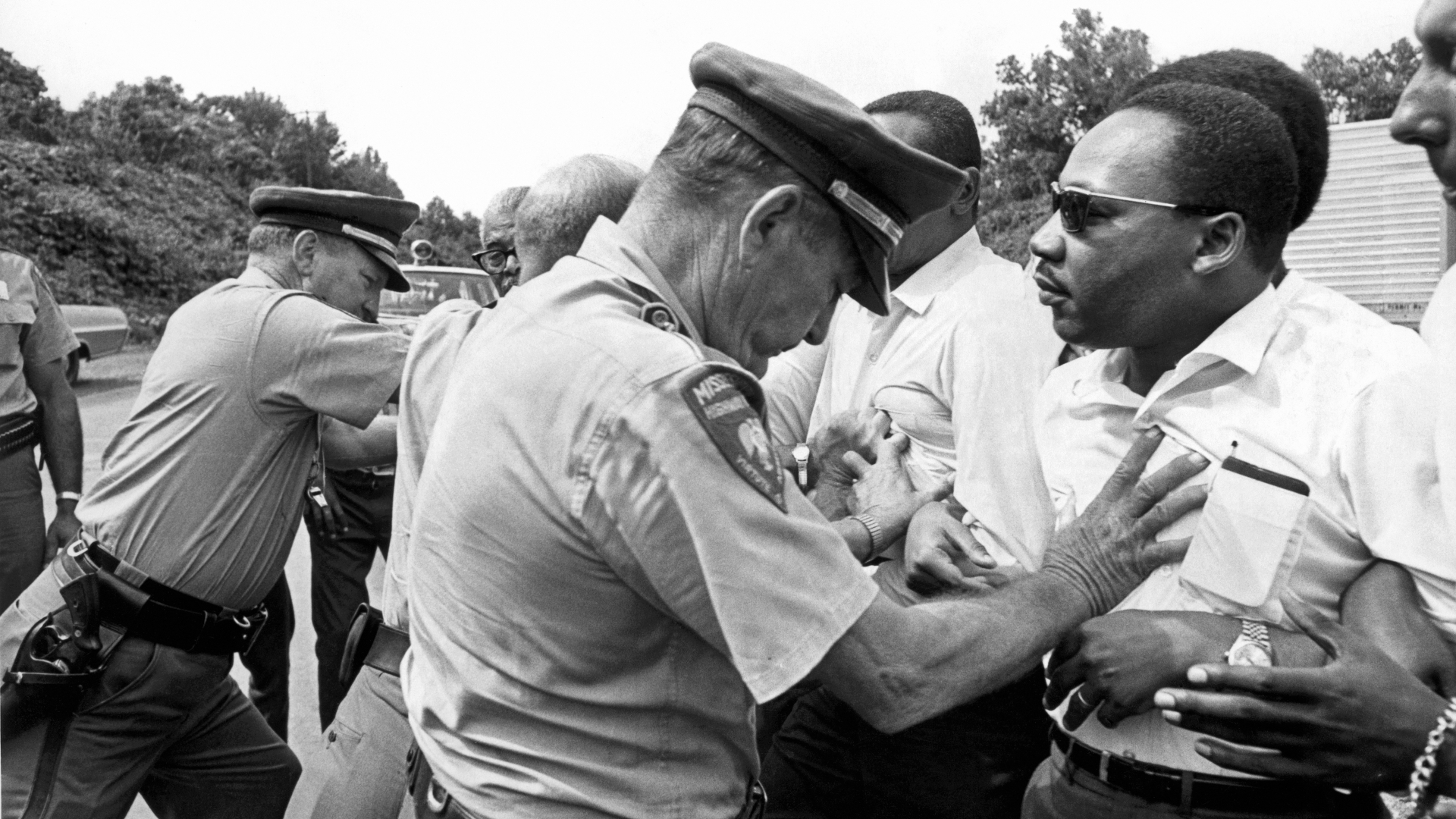 Dr. Martin Luther King being shoved back by Mississippi patrolmen during the 220 mile 'March Against Fear' from Memphis, Tennessee to Jackson, Mississippi, June 8, 1966. (Credit: Underwood Archives/Getty Images)