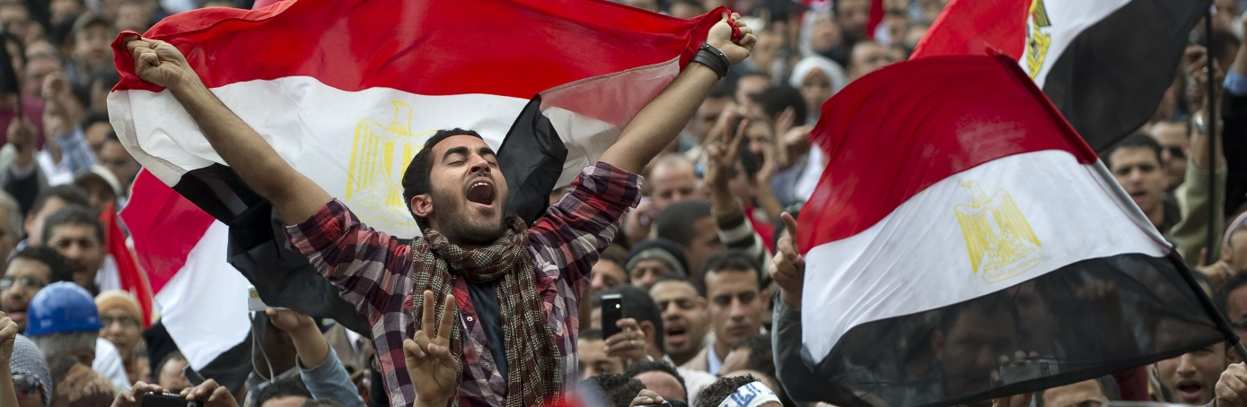 Egyptian anti-goverment demonstrators wave Egyptian flags at Cairo's Tahrir Square on February 10, 2011 on the 17th day of protests against President Hosni Mubarak's regime. (Credit: Pedro Ugarte/AFP/Getty Images)