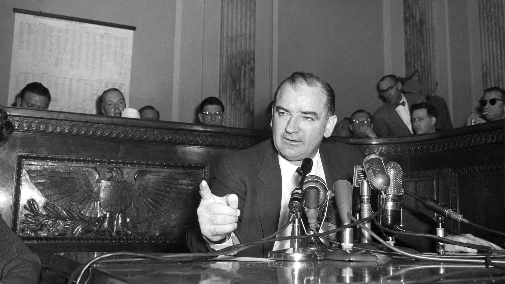 Senator Joseph McCarthy, best known for his wide-ranging witch hunt to root out communism in postwar America, fomented fear and disapproval of elites. He especially denounced the 'egg-sucking phony liberals' who defended 'communists and queers.' (Credit: Bettmann Archive/Getty Images)