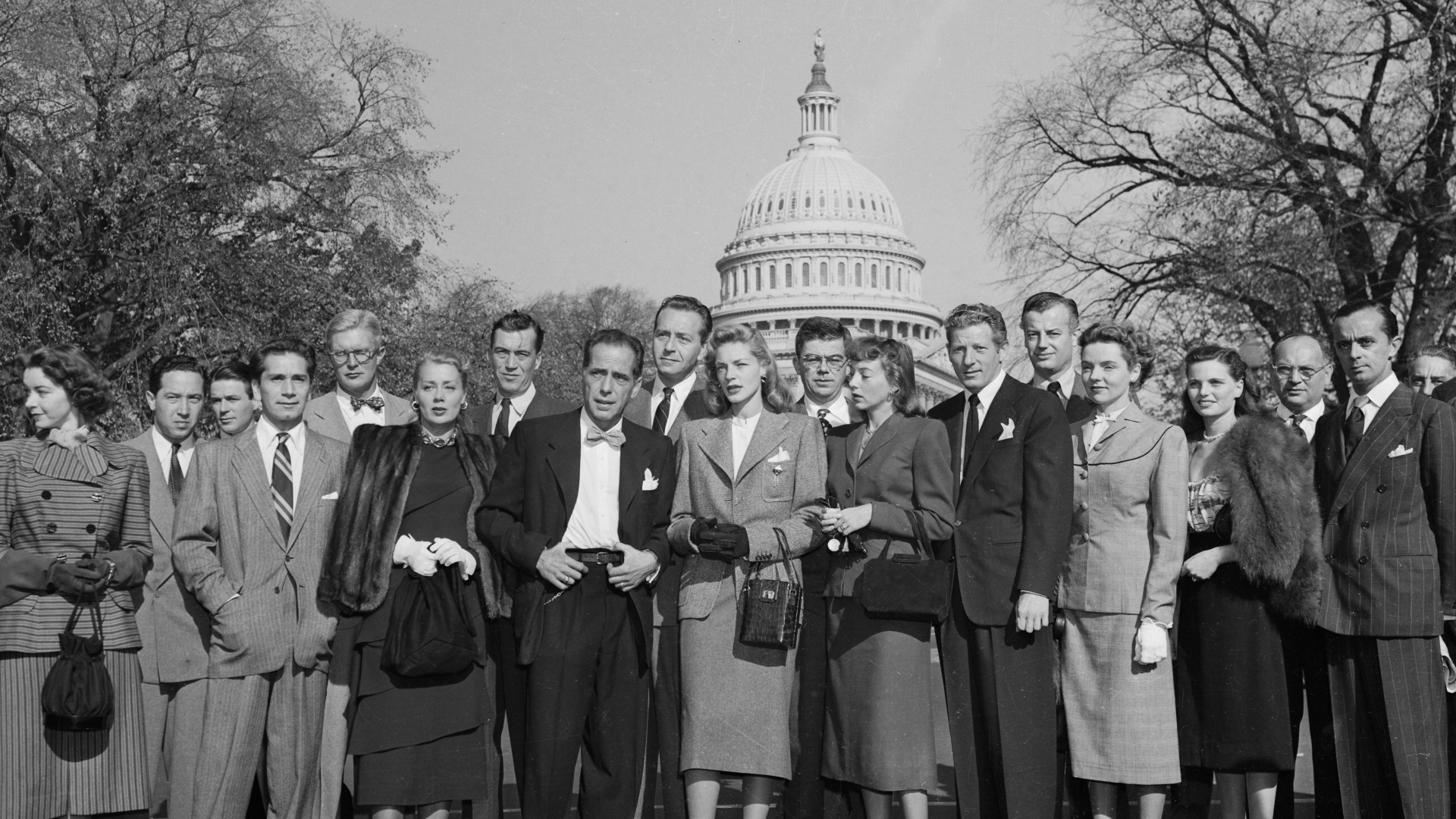 A group of Hollywood celebrities at the Capitol to protest the tactics of the House Un-American Activities Committee's investigation into alleged Hollywood communism. This photo includes actors like Humphrey Bogart and Lauren Bacall. (Credit: Bettmann Archive/Getty Images)
