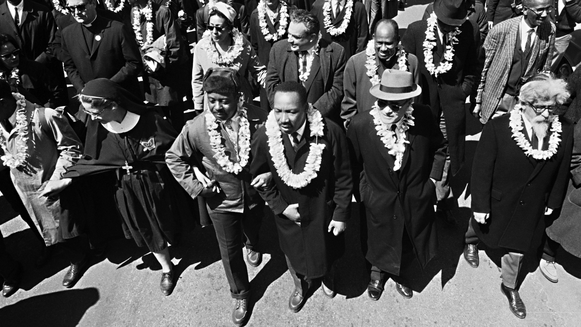 Dr. Martin Luther King, Jr.leading marchers as they begin the Selma to Montgomery civil rights march from Brown's Chapel Church in Selma, Alabama. (Credit: Bettmann Archive/Getty Images)