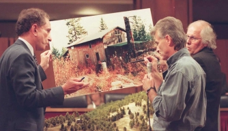 Randy Weaver (C) showing a model of his Ruby Ridge, Idaho cabin to US Senator Arlen Specter on Capitol Hill during Senate hearings investigating the events surrounding the 1992 standoff with federal agents. Weavers' wife and son were killed by FBI agents during the seige. (Credit: Pamela Price/AFP/Getty Images)